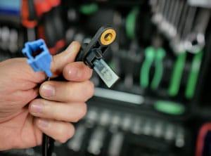 ABS sensor in mechanic's hand
